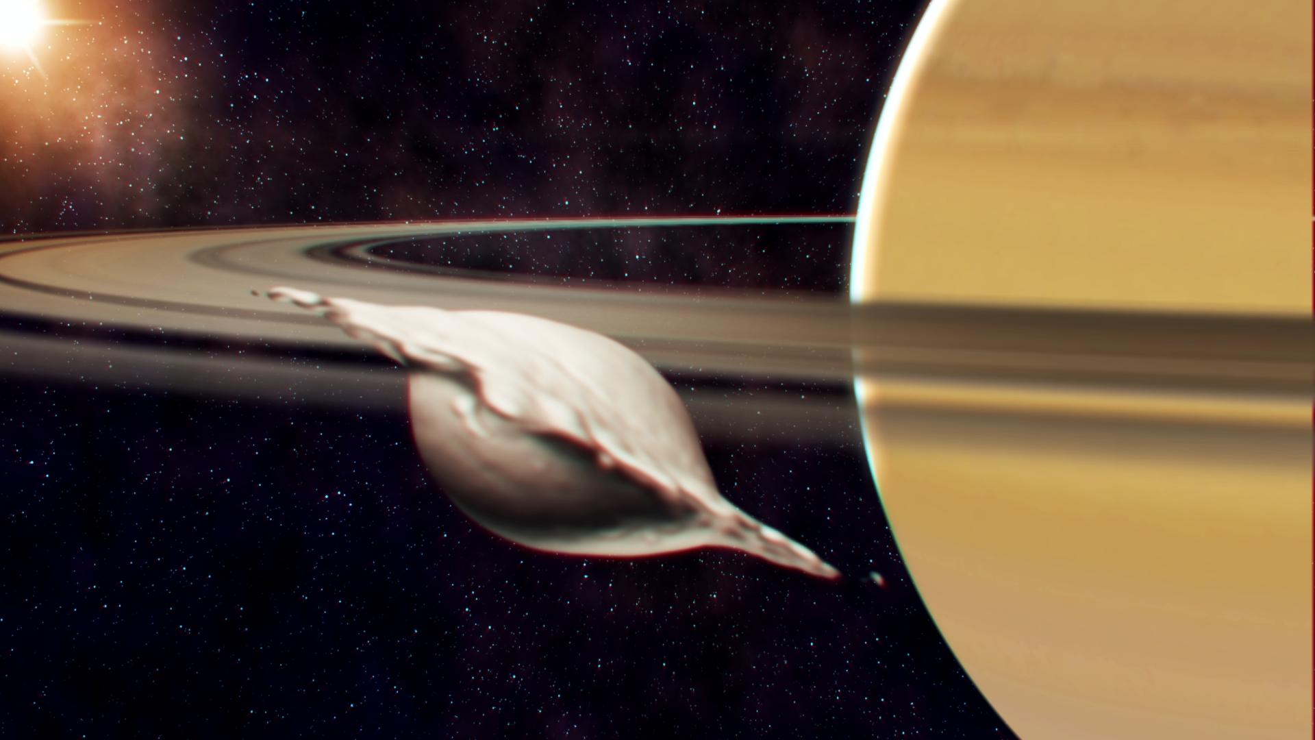 Entstehung von Atlas, einem der kleinen, inneren Monde des Saturns. Seine flache, ravioliartige Form kam bei der Kollision und Verschmelzung zweier gleich grosser Körper zustande. Die Illustration zeigt einen Moment, bevor die Neuausrichtung des Mondes aufgrund der Gezeiten abgeschlossen ist. © A. Verdier