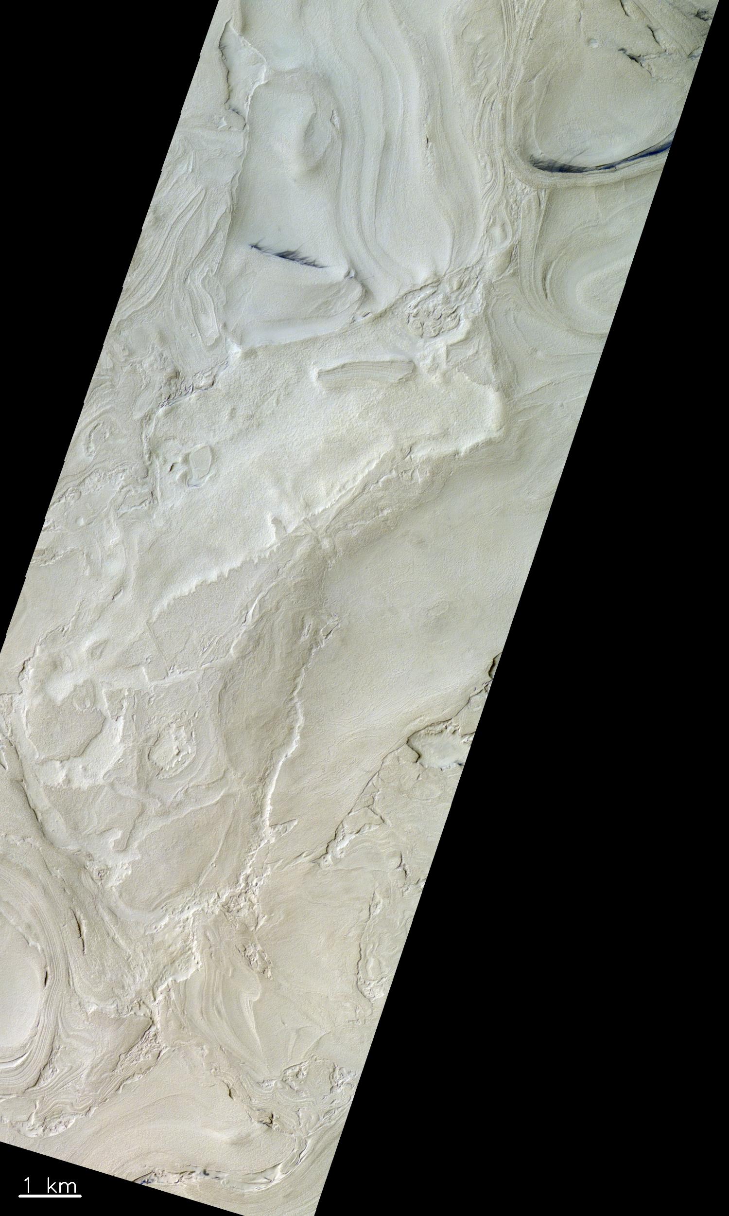Ein Gebiet in der Region des Hellas-Beckens auf dem Mars. Dieses Bild stammt aus dem westlichen Teil des Beckens, in der sich die tiefgelegensten Stellen des Mars befinden (bis zu 7 km unter der definierten Nulllinie). © ESA/Roscosmos/CaSSIS